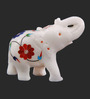 The Nodding Head White Stoneware Trunk Up Elephant with Blue & Red Flowers Showpiece